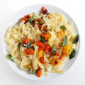 Pasta with grilled cherry tomatoes high angle Stock Images