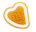 Pasta heart shape - healthy eating concept Royalty Free Stock Images