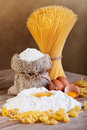 Pasta with ingredients flour and eggs on old wooden table Stock Images
