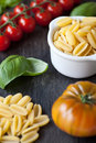 Pasta ingredients tomato basil shallow dof Stock Image