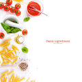 Pasta ingredients - tomatoes, olive oil, garlic, italian herbs, fresh basil and spaghetti on a white board background Royalty Free Stock Photo