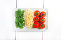 Pasta italian flag made with tomato and basil Royalty Free Stock Images