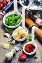 Pasta and italian ingredients spaghetti on wooden table Stock Images