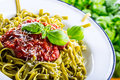 Pasta. Italian and Mediterranean cuisine. Pasta Fettuccine with tomato sauce basil leaves garlic and parmesan cheese. An old home Royalty Free Stock Photo