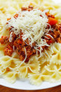 Pasta with meat cheese garnish and Stock Images