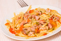 Pasta with meat on plate Stock Image