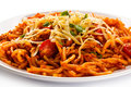 Pasta with meat tomato sauce parmesan and vegetables Stock Photo