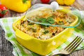 Pasta mushrooms and cheese gratin in casserole dish Stock Photo