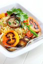 Pasta with mushrooms and tamarillos Stock Photos