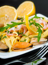 Pasta with mussels mediterranean cuisine shrimp and lemon Stock Photography
