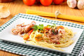 Pasta with octopus tomatoes and carrots on complex background Royalty Free Stock Photo
