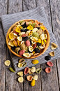 Pasta orecchiette different colors in a wooden bowl on a wooden surface Stock Image