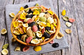 Pasta orecchiette different colors in a wooden bowl on a wooden surface Royalty Free Stock Photos