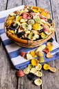 Pasta orecchiette in a wicker basket on a wooden surface Royalty Free Stock Image