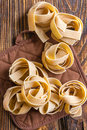 Pasta pappardelle on a wooden table Stock Image