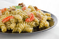 Pasta with pesto and parmesan cheese Royalty Free Stock Images