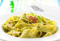 Pasta with pesto and walnuts tagliatelle on white plate Royalty Free Stock Photography