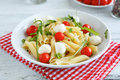 Pasta on a plate with cherry tomatoes and mozzarella cheese italian food Royalty Free Stock Photography