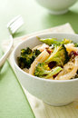 Pasta primavera closeup of with roasted broccoli and sun dried tomatoes Royalty Free Stock Photos