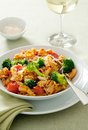 Pasta primavera closeup of with tomatoes broccoli garlic and grated parmesan cheese Stock Images