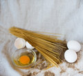 Pasta with raw and whole eggs and flour meal cooking process wheat Stock Photography