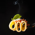 Pasta rigatoni with ragã  parmesan and basil on fork black background Stock Photography