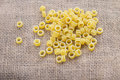Pasta rings on background sacking Royalty Free Stock Images