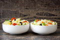 Pasta salad in a bowl on rustic wooden background Royalty Free Stock Photo