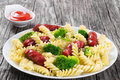 Pasta salad with broccoli and grilled sausages, close-up Royalty Free Stock Photo