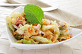 Pasta salad closeup of a bowl with refreshing on a set table Stock Photography