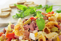 Pasta salad closeup of a refreshing with feta cheese tomato olives and frankfurter sausages Royalty Free Stock Images