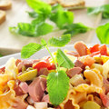 Pasta salad closeup of a refreshing with feta cheese tomato olives and frankfurter sausages Stock Images