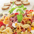 Pasta salad closeup of a refreshing with feta cheese tomato olives and frankfurter sausages Royalty Free Stock Photos