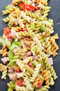 Pasta salad closeup of a refreshing on a slate background Stock Image