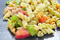 Pasta salad closeup of a refreshing on a slate background Royalty Free Stock Images