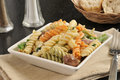 Pasta salad mediterranean with greek olives and dinner rolls Stock Photography