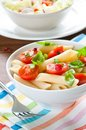 Pasta salad with penne cherry tomatoes and basil Stock Images
