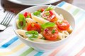 Pasta salad with penne cherry tomatoes and basil Royalty Free Stock Photography