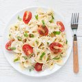Pasta salad with tie pasta, feta cheese, cherry tomatoes, mustard and basil, top view, square Royalty Free Stock Photo