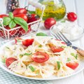 Pasta salad with tie pasta, feta cheese, cherry tomatoes, mustard and basil, square Royalty Free Stock Photo
