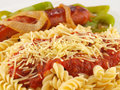 Pasta and Sauce with Sausage and Peppers Stock Images