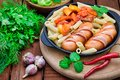 Pasta with sausages and lecho. Wooden rustic background. Selective focus. Top view