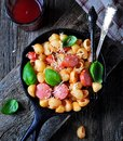 Pasta with sausages in tomato sauce with basil and cheese Royalty Free Stock Photo