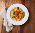 Pasta with seafood and vegetables on a plate on a wooden background Royalty Free Stock Photo