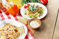 Pasta with shrimps and mashrooms herbs on the wooden table Stock Photography