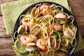 Pasta spaghetti with clam, shrimp, chili and lime close-up. hori Royalty Free Stock Photo
