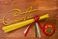 Pasta spaghetti tied with ribbons of the flag colors of Italy Royalty Free Stock Photo