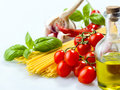 Pasta spaghetti vegetables spices and oil with Royalty Free Stock Photos