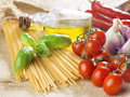 Pasta spaghetti vegetables spices and oil Stock Photos