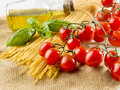 Pasta spaghetti vegetables spices and oil with Stock Images